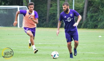 Orlando City SC midfielder Antonio Nocerino, right, dribbles the ball during a training session at Sylvan Lake Park on Friday, Sept. 2, 2016. (Photo by Victor Tan / New Day Review)